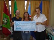 Giassi Supermercados doa troco solidário à Família Feliz