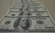 Dólar bate recorde na bolsa e fecha em R$ 5,84 após corte de juros no país