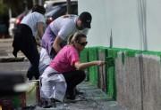 Voluntários promovem pintura em escola no Dia de Cooperar