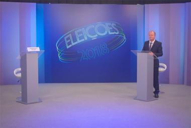 Moisés falta ao debate e tenta impedir entrevista com Merisio